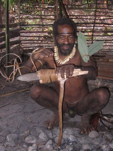 Papua Kombai – Tree people – reparation of stone axe